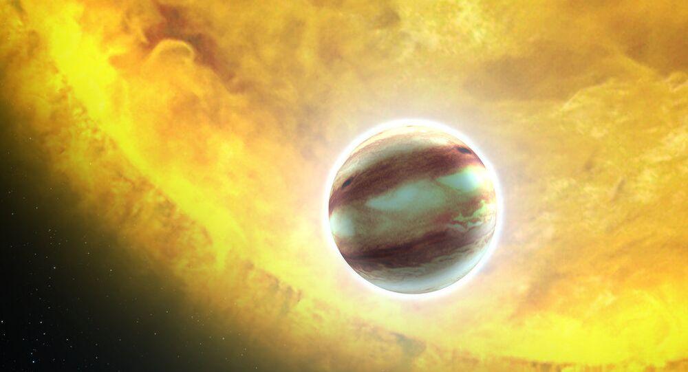 Una estrella y un planeta