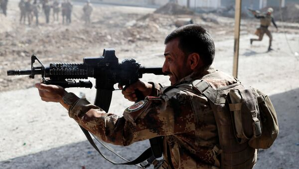 Militante iraquí - Sputnik Mundo