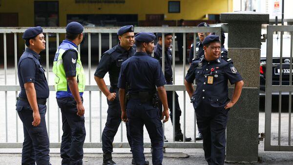 Policías de Malasia - Sputnik Mundo