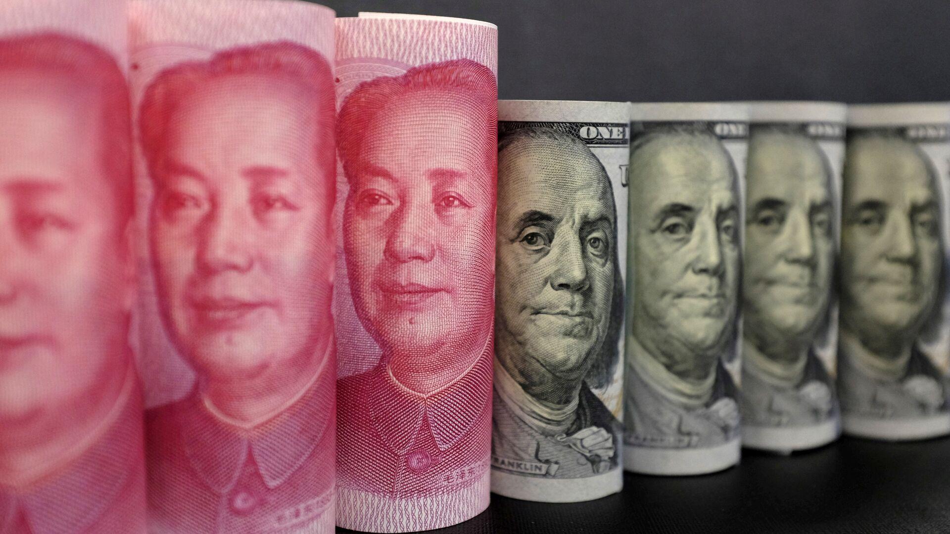 Yuanes chinos y dólares estadounidenses - Sputnik Mundo, 1920, 26.12.2020