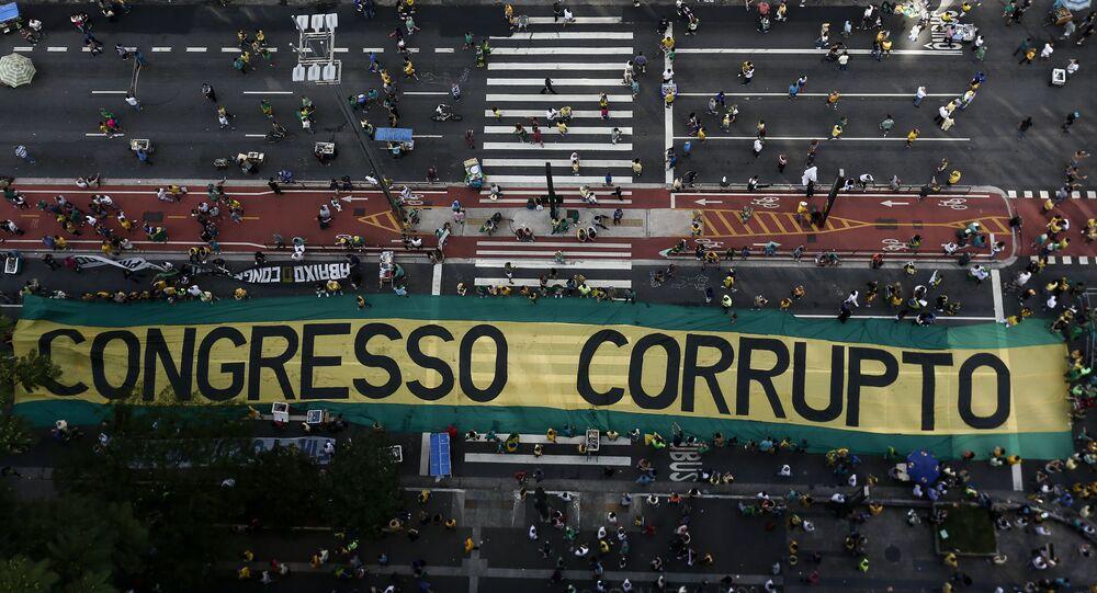 Demonstrators protest along Paulista Avenue in Sao Paulo, Brazil