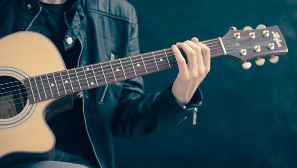 Un guitarrista (archivo) - Sputnik Mundo