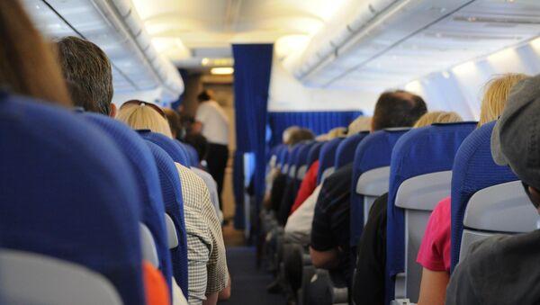 Cabina de pasajeros de un avión (imagen referencial) - Sputnik Mundo