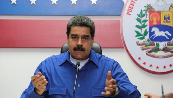 Venezuela's President Nicolas Maduro speaks during a meeting with ministers in Caracas, Venezuela - Sputnik Mundo