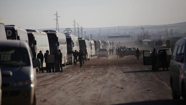 Autobuses con insurgentes en la ciudad siria de Homs (Archivo) - Sputnik Mundo