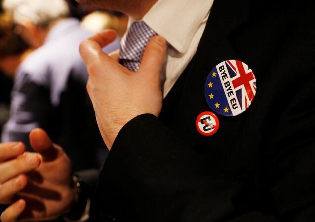 A man adjusts his tie at a Pro-Brexit event to celebrate the invoking of Article 50