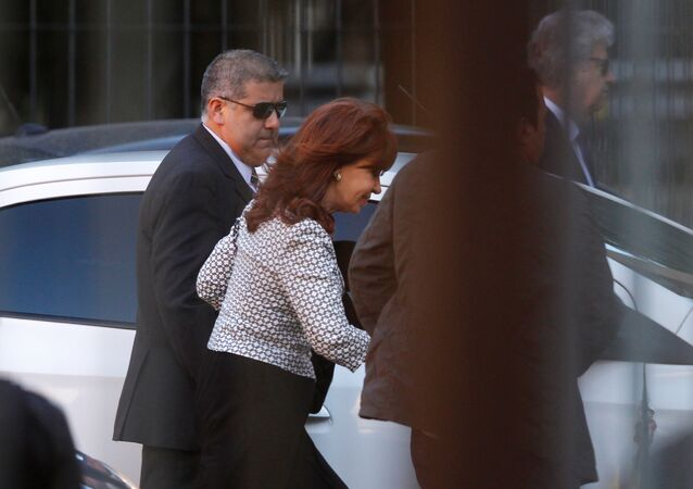 Argentina's former President Cristina Fernandez de Kirchner (C) arrives at court over accusations of bribery and money laundering, in Buenos Aires, Argentina March 7, 2017