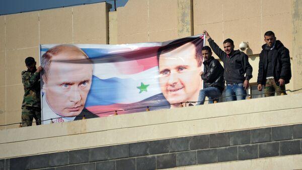 Manifestación de los estudiantes de la Universidad Baas en apoyo de las operaciones aéreas rusas en Siria - Sputnik Mundo
