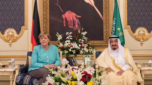 Angela Merkel, canciller de Alemania, y Salman Bin Abdul Aziz Al Saud, rey de Arabia Saudí - Sputnik Mundo