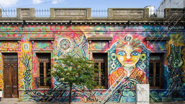 Mural de Julián Roura - Sputnik Mundo