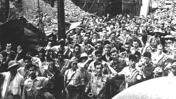 Soldados estadounidenses y filipinos se rinden a las tropas invasoras japonesas, en mayo de 1942, en la isla de Corregidor, Filipinas - Sputnik Mundo