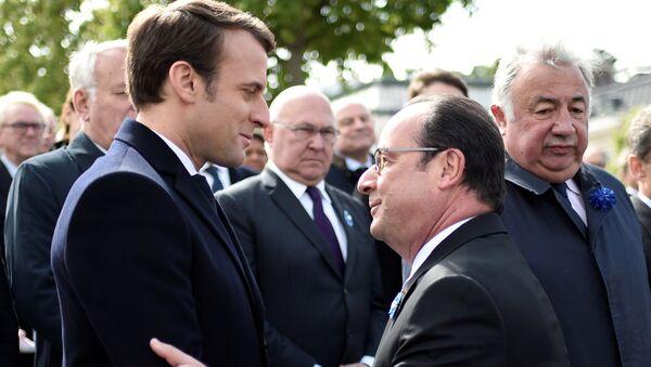 Emmanuel Macron, presidente electo de Francia, y François Hollande, presidente saliente - Sputnik Mundo