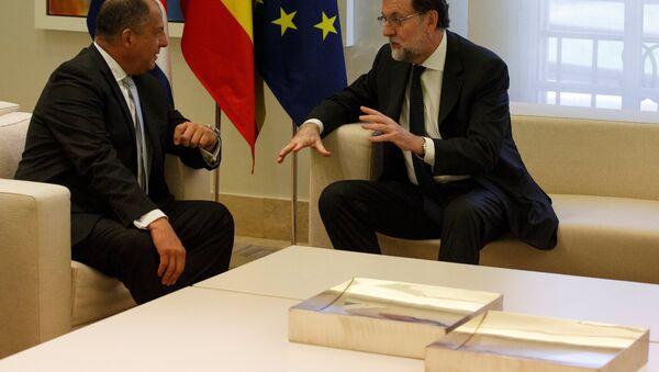 El presidente del Gobierno español, Mariano Rajoy, con el presidente de Costa Rica, Luis Guillermo Solís - Sputnik Mundo