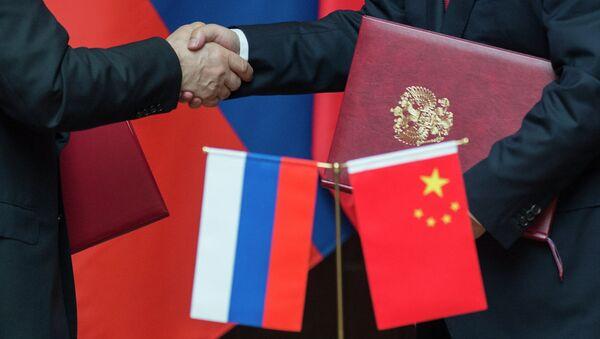 Las banderas de Rusia y China - Sputnik Mundo