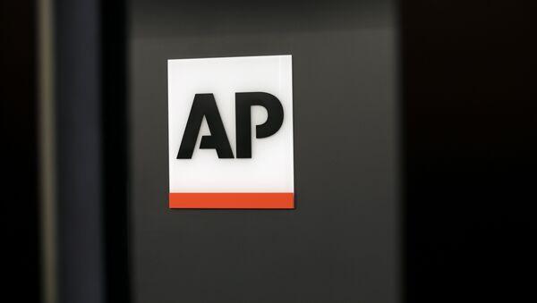 Logo de la agencia AP - Sputnik Mundo