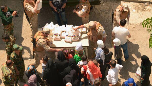 Ayuda humanitaria rusa para Latakia (archivo) - Sputnik Mundo