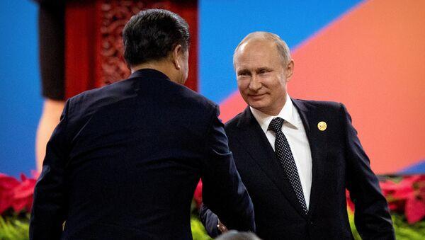Xi Jinping, presidente de China y Vladímir Putin, presidente de Rusia - Sputnik Mundo
