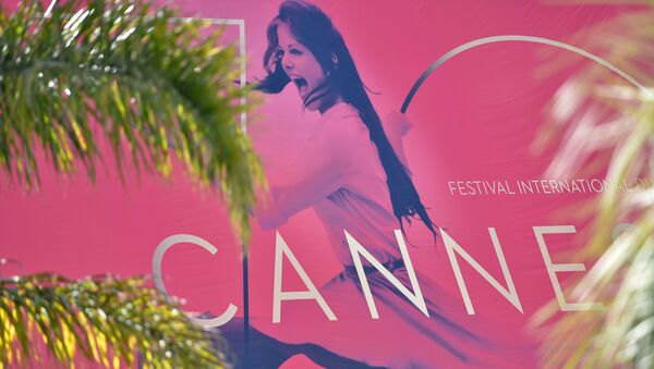 A picture taken on May 15, 2017 in Cannes, southeastern France, shows the affiche for the 70th Cannes Film Festival hanging from the facade of the Palais des Festivals - Sputnik Mundo