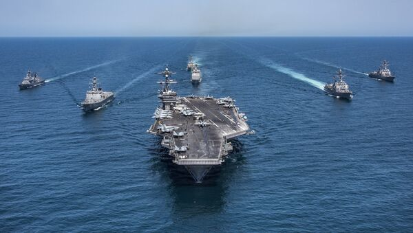 In this image released by the U.S. Navy, the aircraft carrier USS Carl Vinson, flanked by South Korean destroyers, from left, Yang Manchun and Sejong the Great, and the U.S.Navy's Wayne E. Meyer and USS Michael Murphy, transit the western Pacific Ocean Wednesday, May 3, 2017. - Sputnik Mundo