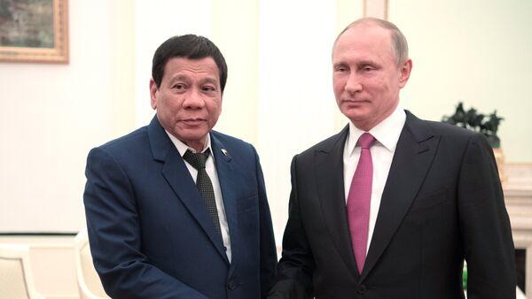 Rodrigo Duterte, presidente de Filipinas, y Vladímir Putin, presidente de Rusia (Archivo) - Sputnik Mundo