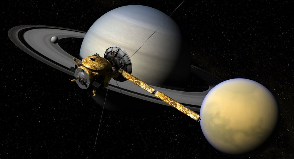 Ilustración gráfica de la sonda Cassini, el planeta Saturno y su satélite Titan