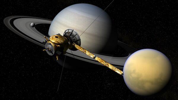 Ilustración gráfica de la sonda Cassini, el planeta Saturno y su satélite Titan - Sputnik Mundo