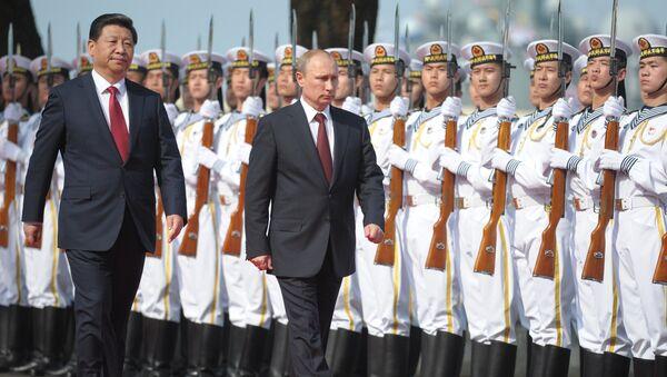 El presidente ruso Vladímir Putin y el presidente de China Xi Jinping - Sputnik Mundo