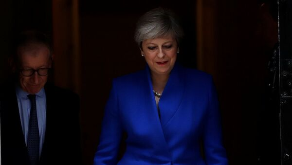 Britain's Primer Minister Theresa May leaves Downing Street on her way to Buckingham Palace after Britain's election in London, Britain - Sputnik Mundo