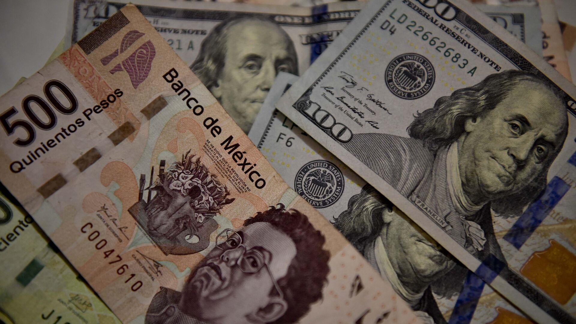 Peso mexicano y dólar estadounidense - Sputnik Mundo, 1920, 17.04.2021