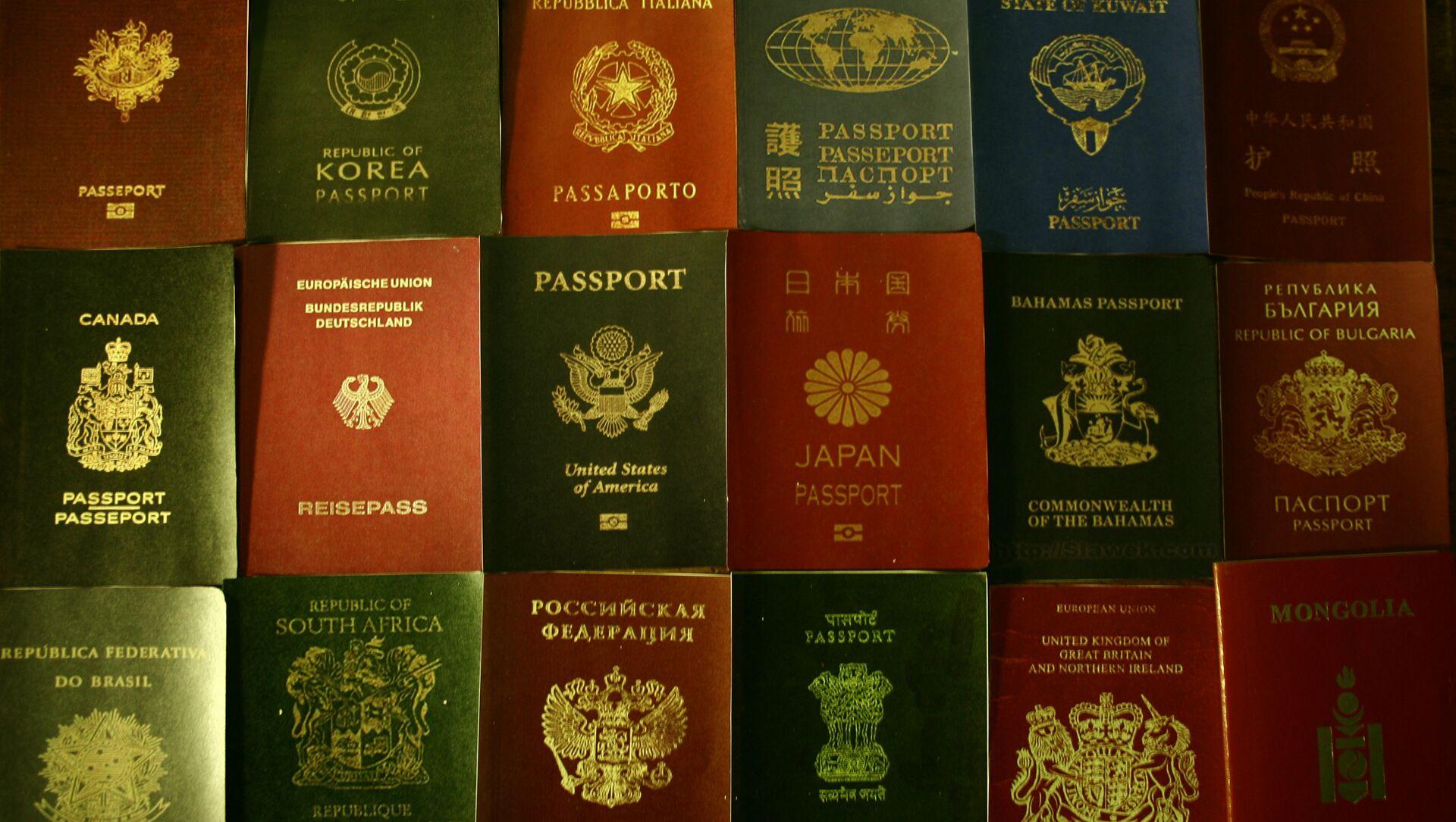 Pasaportes (imagen referencial) - Sputnik Mundo, 1920, 01.02.2021