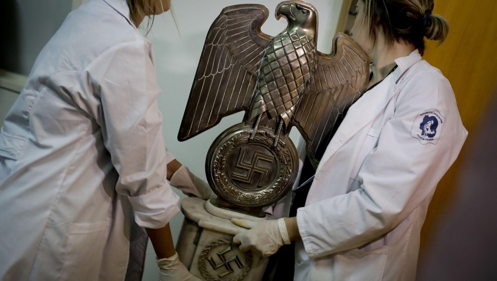 Artefactos con simbología nazi encontrados en Argentina en junio de 2017 - Sputnik Mundo, 1920, 28.11.2020