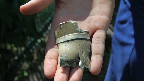 Un fragmento de proyectil en Donetsk, Ucrania - Sputnik Mundo