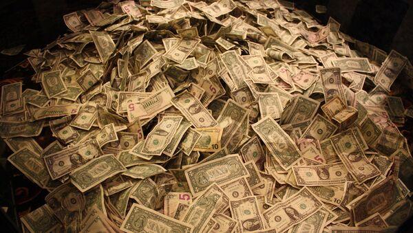 Un montón de dólares (imagen referencial) - Sputnik Mundo