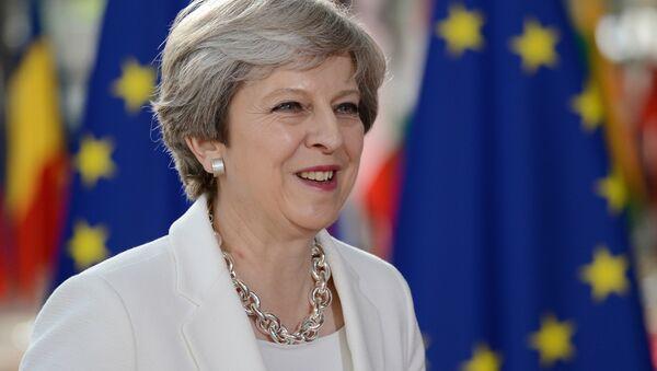 Theresa May, primera ministra de el Reino Unido - Sputnik Mundo