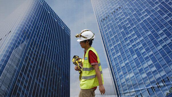 Trabajador chino en Pekín, China - Sputnik Mundo