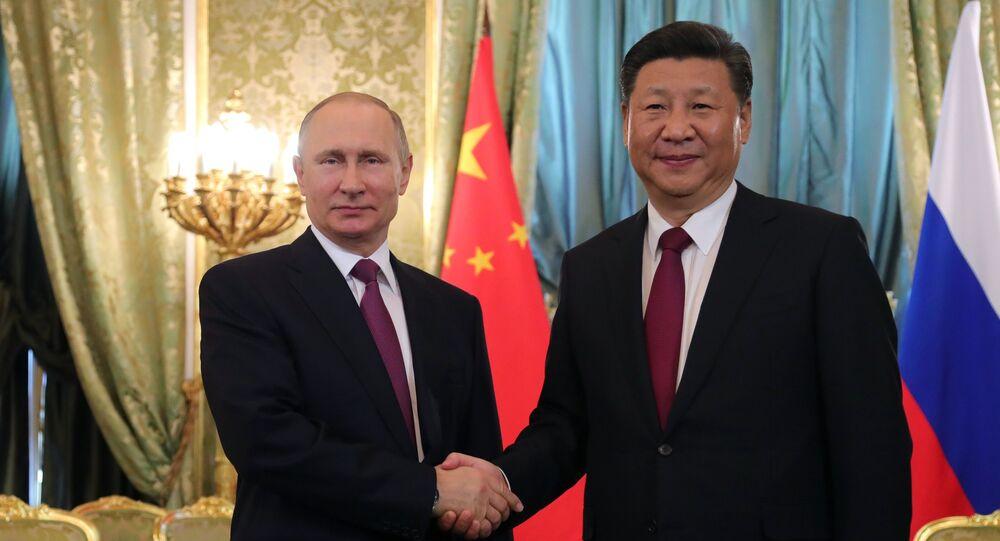 El presidente ruso, Vladímir Putin con  su homólogo chino, Xi Jinping
