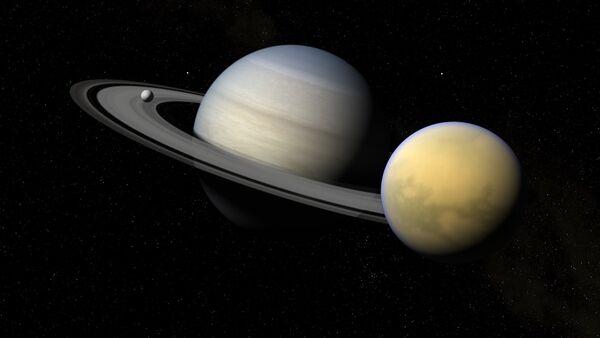 Saturno y sus satélites Titán y Encélado - Sputnik Mundo