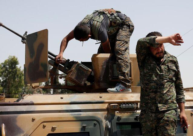 Los combatiented de Unidades kurdas de Protección Popular (YPG) en Siria