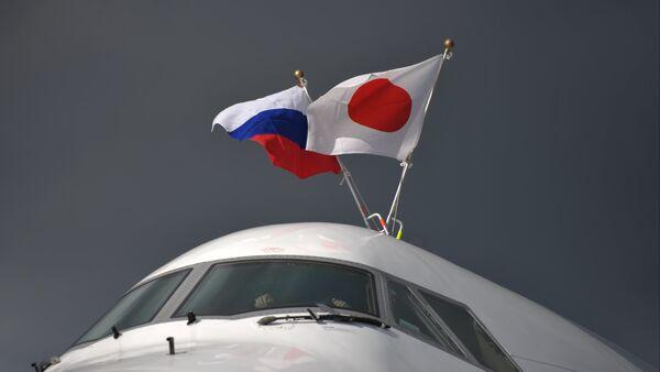 Las banderas de Rusia y Japón - Sputnik Mundo