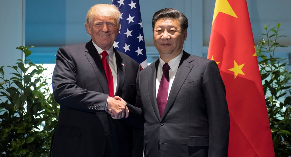 Donald Trump, presidente de EEUU, y Xi Jinping, líder chino, en Pekín