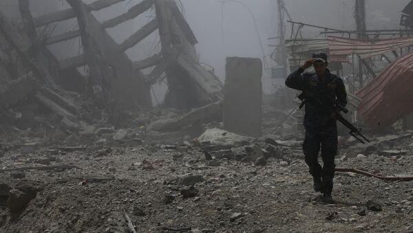 Un policía iraquí en Mosul (archivo) - Sputnik Mundo