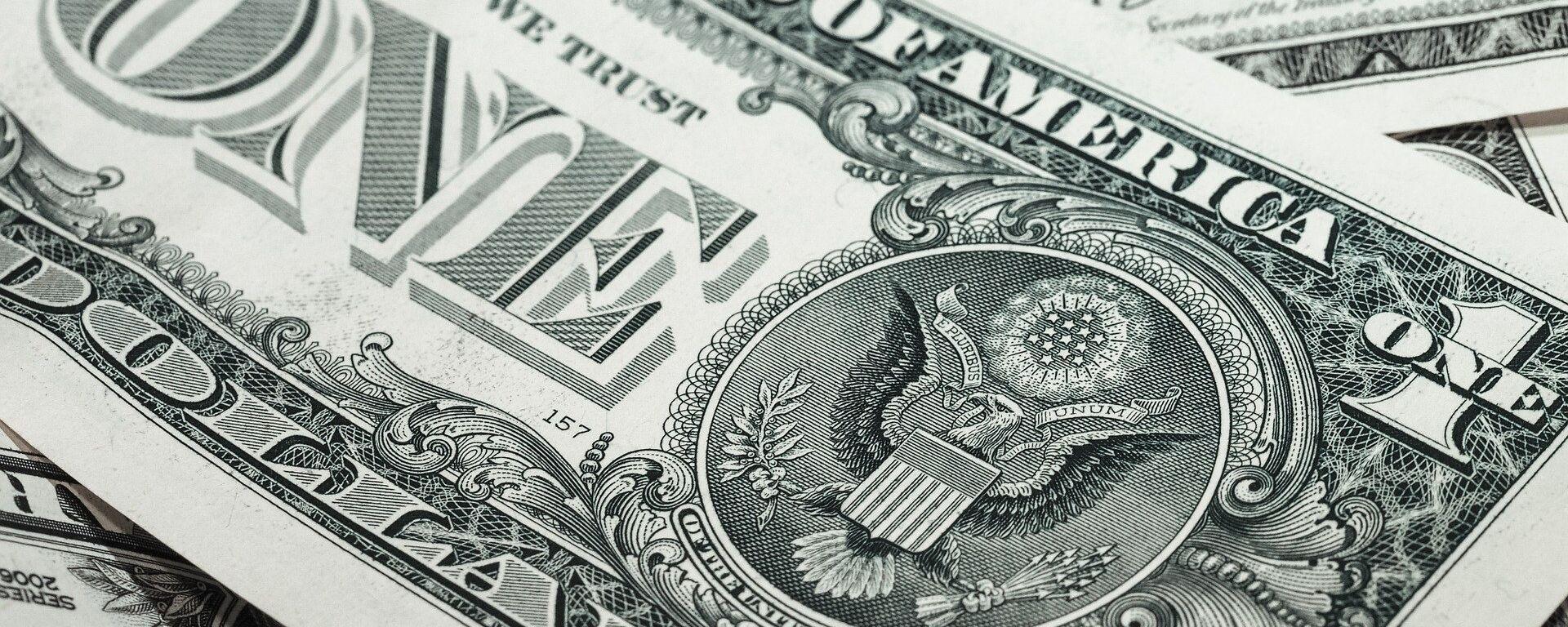Dólar, moneda de EEUU - Sputnik Mundo, 1920, 19.04.2021