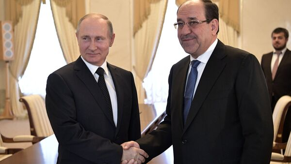 El presidente de Rusia, Vladímir Putin con el vicepresidente iraquí, Nouri Maliki - Sputnik Mundo