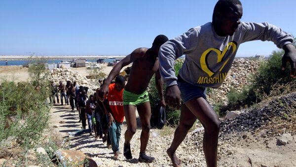 Los migrantes libios (archivo) - Sputnik Mundo
