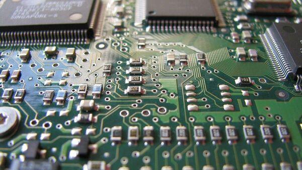 Un microchip - Sputnik Mundo