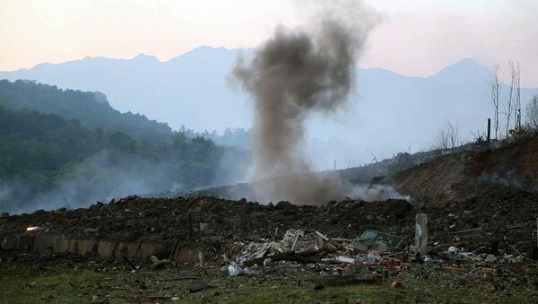 El lugar de la explosión en un arsenal en Abjasia - Sputnik Mundo