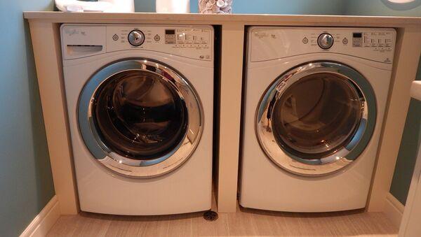 Una lavadora - Sputnik Mundo