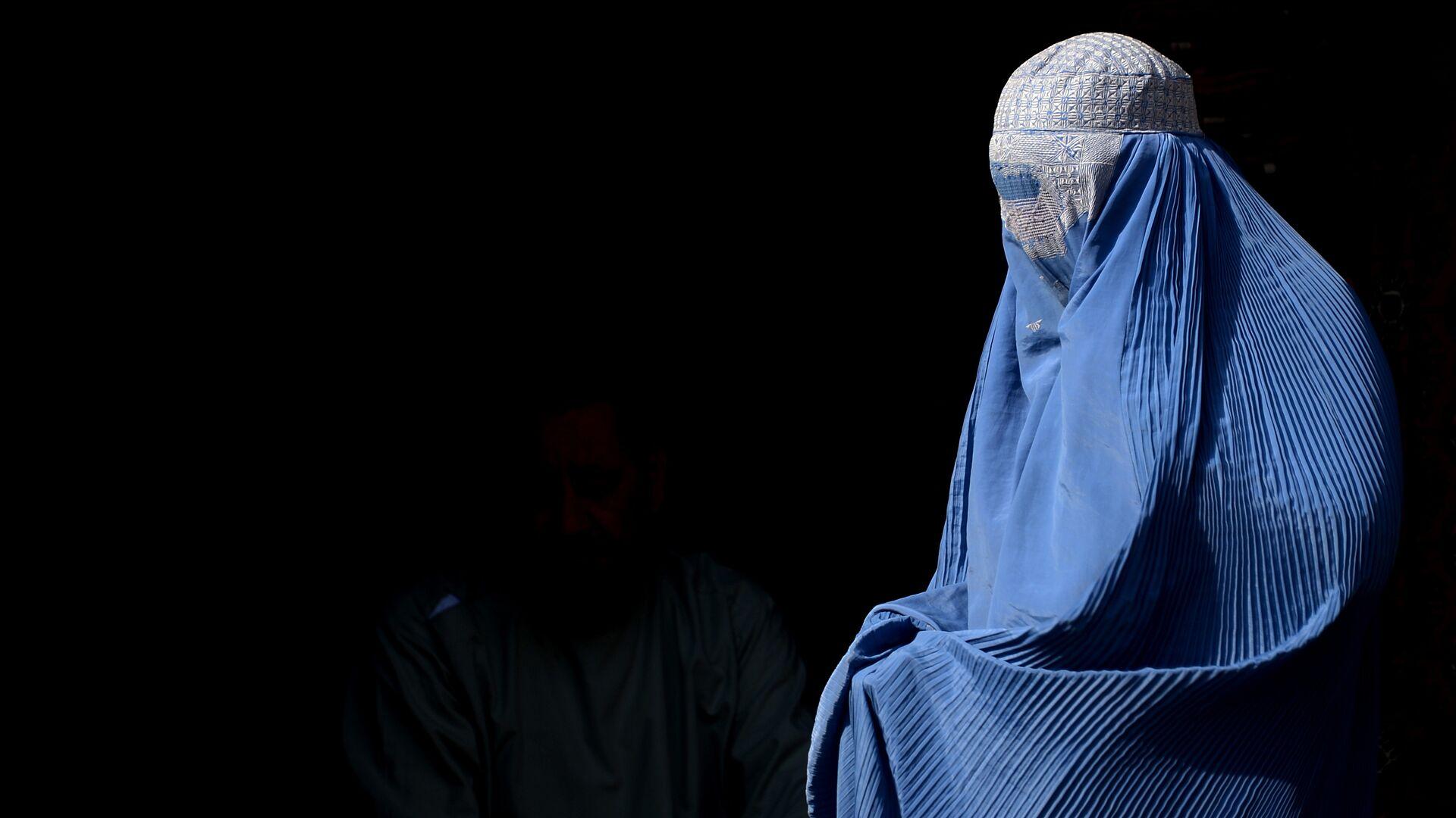 Una mujer en burka (imagen referencial) - Sputnik Mundo, 1920, 09.09.2021