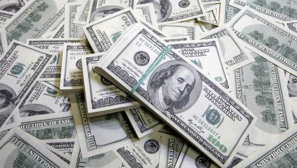 Dólares estadounidenses (archivo) - Sputnik Mundo