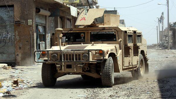 Un vehículo militar en Al Raqa (imagen referencial) - Sputnik Mundo